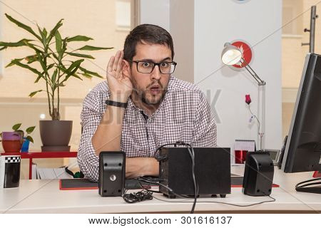 Businessman In The Office With A Gesture Of Listening