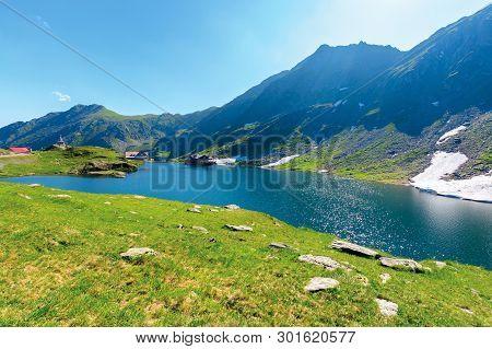 Beautiful Summer Scenery Around Balea Lake. Grassy Meadows And Rocky Ridge Around. Popular Travel De