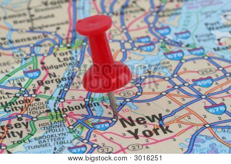 Close up of map of New York with push pin on city poster