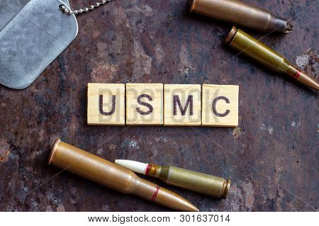 Usmc Sign With Weapon Bullets And Army Dog Tags On Rusty Metal Background. Military Industry, United