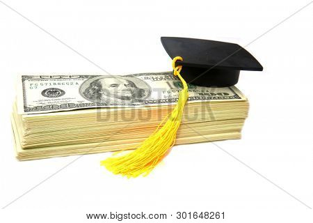 American Money with Graduation Cap. Collage Tuition Scandal. Isolated on white. Room for text. Cost of education.