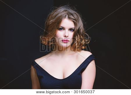 Woman With Curly Hairstyle And Makeup On Black Background. Makeup Idea For Elegant Outfit. Attractiv