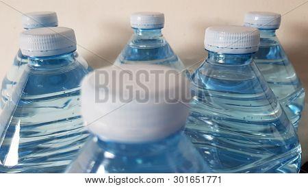 Plastic Bottles Focus On The Far Row Of Caps