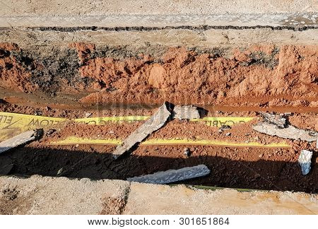 A Trench Showing A Cross Section Of A Road.