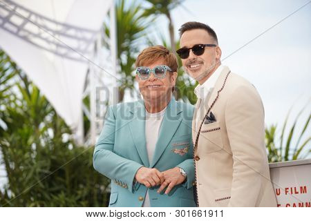 Elton John and David Furnish attend the photocall for