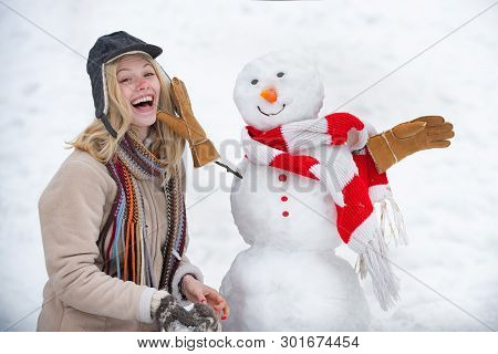 Winter Love Concept. Making Snowman And Winter Fun. Give A Wink. Young Woman Winter Portrait. Sensua