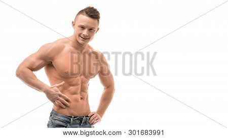 Smiling Athletic Man Showing Muscular Body And Sixpack Abs Over White Background