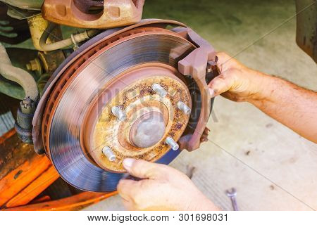 The Car Mechanic Is Checking The Brake System Of The Car, Brake System Of Old And Damaged Cars, Car