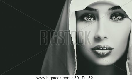 Black and white artistic closeup portrait of beautiful serious young woman