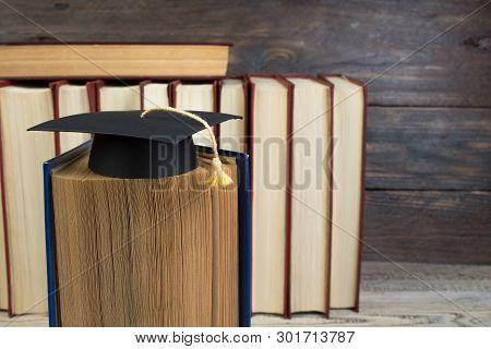 Education Concept. Graduation Hat With Gold Tassel On The Books. Law Concep- With Copy Space For You