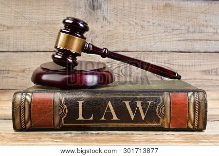 Law Concept . Judge Gavel On The Book On Wooden Table. Justice And Law Concept.