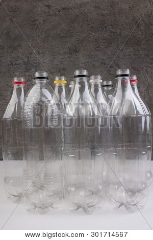 Collection Of Empty Used Plastic Bottles On Bitonny, Gray Background.