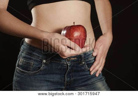 Red Apple In The Hand Of Girl