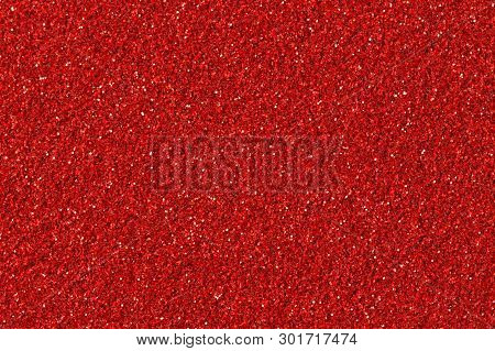 Abstract Red Christmas Glitter Background. Red Glitter Texture Close-up.