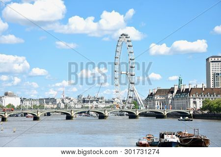 London, England: May 15, 2019 - The London Eye On The South Bank Of The River Thames At Night In Lon
