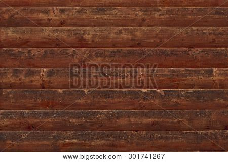 Brown Shabby Wooden Planks. Surface Of A Wooden Decrepit Fence. Dilapidated Oak Planking. Texture Of