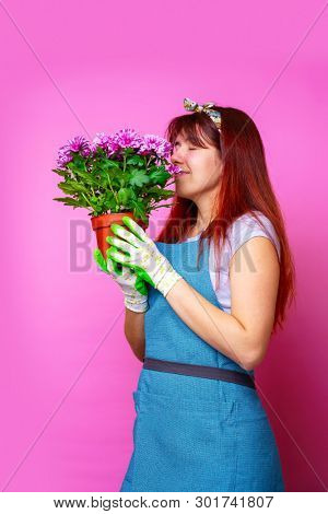 Photo on side of girl with chrysanthemums