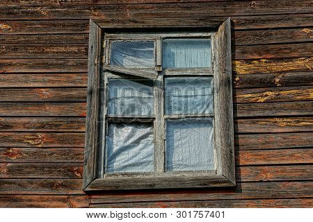 One Old Window On A Brown Wooden Plank Wall