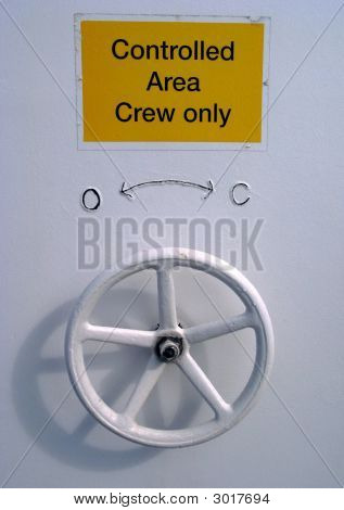 Sign And Wheel Door