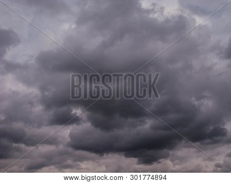 Dark, Storm Clouds. Cloudy Sky. Dark, Heavy, Leaden Clouds Obscure The Sky Causing Twilight And Evok