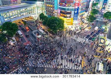 Shibuya Crossing Is One Of The Busiest Crosswalks In The World. Pedestrians Crosswalk At Shibuya Dis