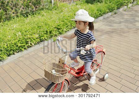 Japanese Girl Riding On The Bicycle (4 Years Old)