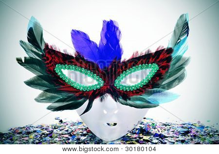 a mask with a carnival mask with feathers and confetti of different colors