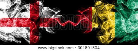 English Vs Guinea, Guinean Smoky Mystic Flags Placed Side By Side. Thick Colored Silky Smokes Flag O