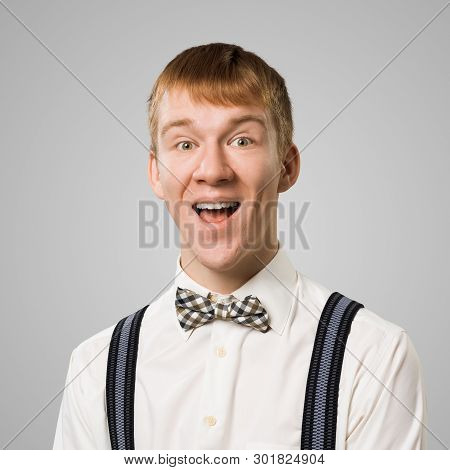 Happy Hipster With Mouth Opened. Emotional Redhead Boy Has Surprised Facial Expression. Portrait Of
