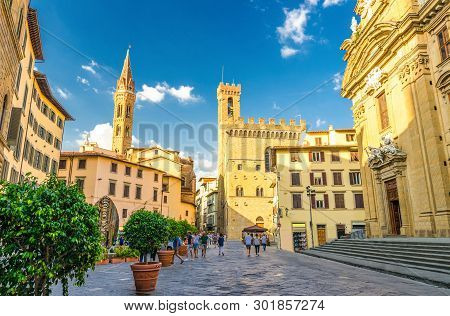 Piazza di San Firenze square with Chiesa San Filippo Neri, Badia Fiorentina Monastero catholic church and Bargello museum in historical centre of Florence city, blue sky white clouds, Tuscany, Italy poster
