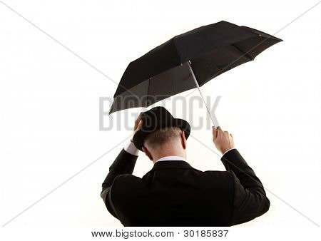 Man with umbrella on the wind