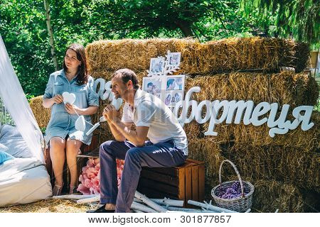 Dnipro / Ukraine - May 18, 2019: Charity Family Festival: Family Is Photographed In The Park On The