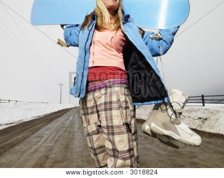 Woman Holding Snowboard.