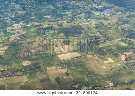 Aerial View Of Greem Farm Fields Forming Geometrical Pattern. Agriculture Landscape Birds Eye View