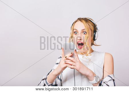 Close Up Portrait Of Cute Ecstatic Glad Woman Reading Something Exciting In Her Iphone. Emotional Bl