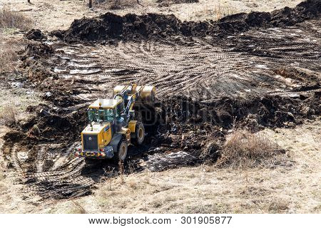 Chelyabinsk Region, Russia - May 2019:view From Above- Bulldozer Pushes The Ground, Tractor Pushes A