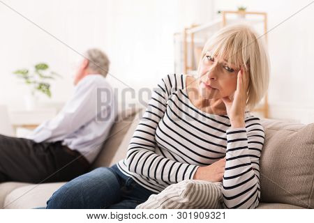 Senior Couple Having Relationship Problems, Looking To Opposite Sides After Argument