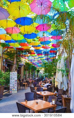 Nicosia, Cyprus - Oct 4th 2018: Outdoor Restaurant Garden With Colorful Umbrellas Decorating The Top