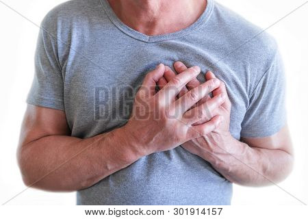The Young Man Is Suffering From Chest Pain. Chest Spasm, Angina Pectoris. Heart Attack