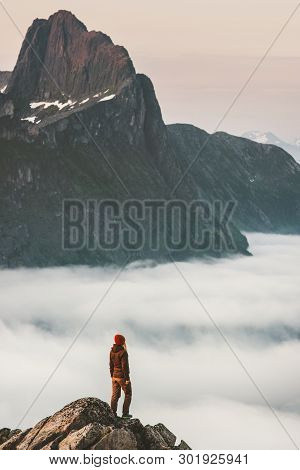 Hiker Girl On Cliff Edge Over Clouds Travel In Mountains Standing Alone Adventure Extreme Journey Ou