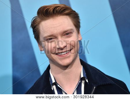 LOS ANGELES - MAY 18:  Calum Worthy arrives for the 'Godzilla: King of the Monstersl' Hollywood Premiere on May 18, 2019 in Hollywood, CA