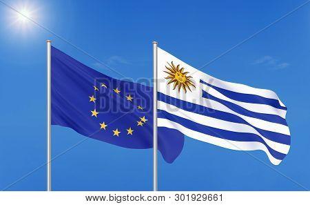 European Union Vs Uruguay. Thick Colored Silky Flags Of European Union And Uruguay. 3d Illustration