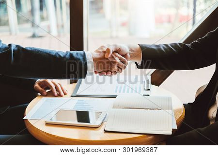 Business People Colleagues Shaking Hands During A Meeting To Sign Agreement For New Partner Planning