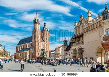 KRAKOW, POLAND - APRIL 19, 2019: St. Mary's Basilica in at the main square (Polish: Rynek Glowny) of the Old Town in Krakow, Poland.