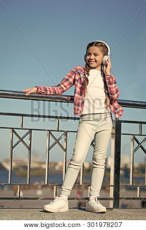 Girl Child Listen Music Outdoors With Modern Headphones. Kids Headphones Tested And Ranked Best To W