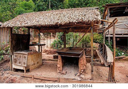 Hut In Boca De Valeria, Brazil. Primitive Dwelling Hut With Dried Grass Roof. Farm Or Village In Tro