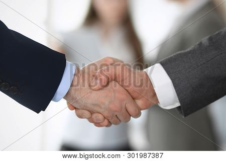 Business People Shaking Hands At Meeting Or Negotiation, Close-up. Group Of Unknown Businessmen And