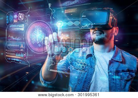 Portrait Of A Man With Glasses Of Virtual Reality, Vr, Interacts With A Virtual Screen. The Concept