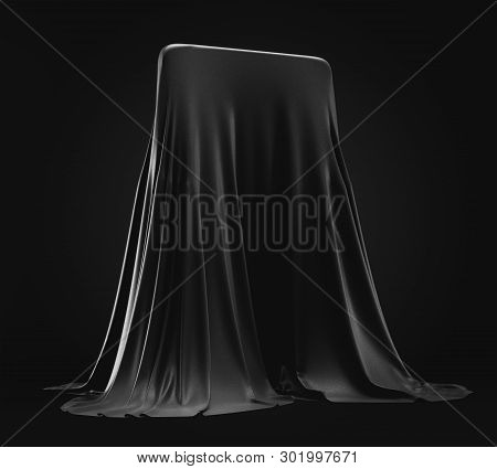Smartphone Design Prototype Hidden Under Black Cloth Cover On Dark Background. New Cellphone Or Mobi