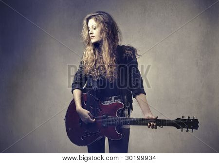 Female rock star playing the guitar